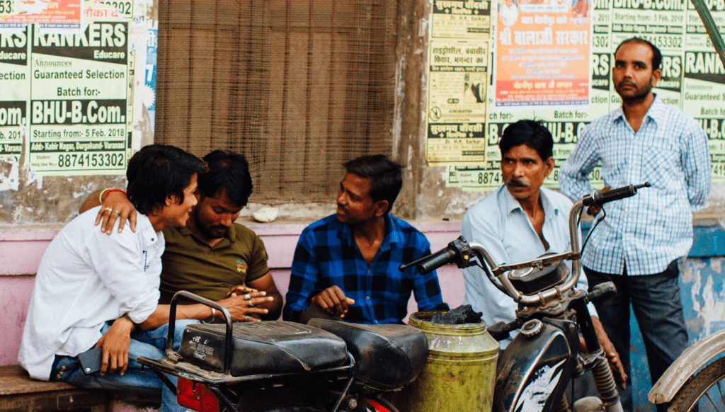 Men in an alley in Varanasi, India. Photo by Adam Cohn, courtesy of Flickr Creative Commons.