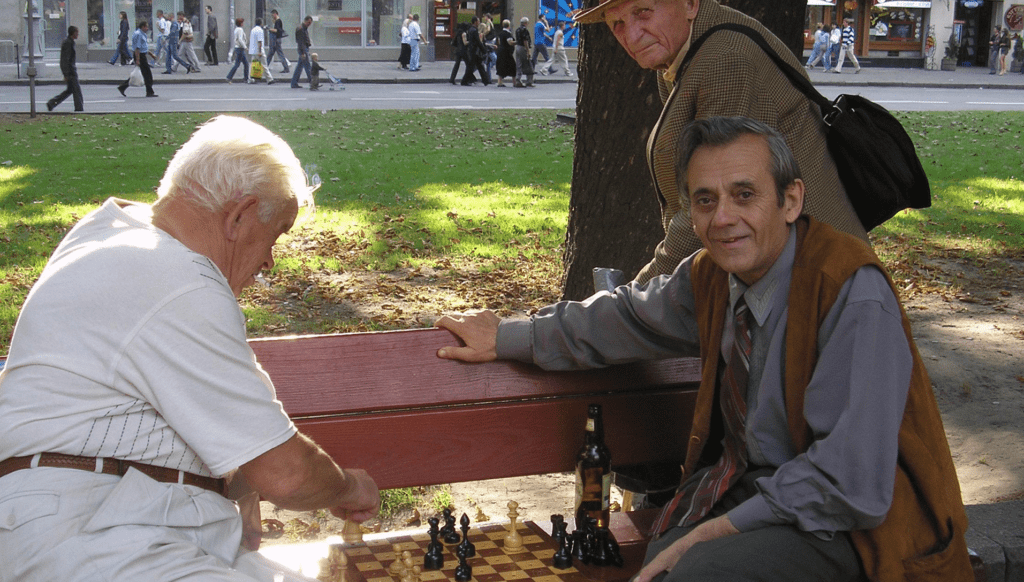 Older men play chess in Ukraine. Photo by Iryna Shabaykovych, courtesy of Photoshare.