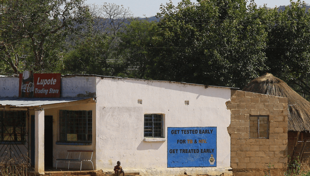 Store shows sign encouraging testing for TB and HIV in Zimbabwe. Photo by Jin Jeong.